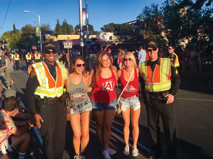Officers pose for photos with fans, offer up bottles of water during outdoor events, and occasionally hand out swag.