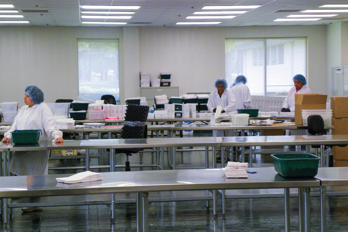 Workers at Sirchie assemble sexual assault evidence collection kits. The kits are produced according to the legal requirements of each state.  - Photo: David Griffith