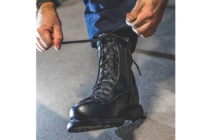 "An Everest (WI) Metro Police Department officer finishes getting ready for duty, tying his Gen-Flex2 Series Waterproof 8"" Tactical Side Zip boot. Wear testers especially appreciated Thorogood boots' traction and stability. - Photo: Thorogood"