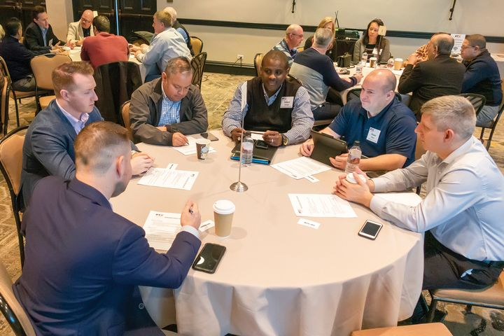 Law enforcement agency representatives discuss their technology challenges and possible solutions during PTX roundtable. -