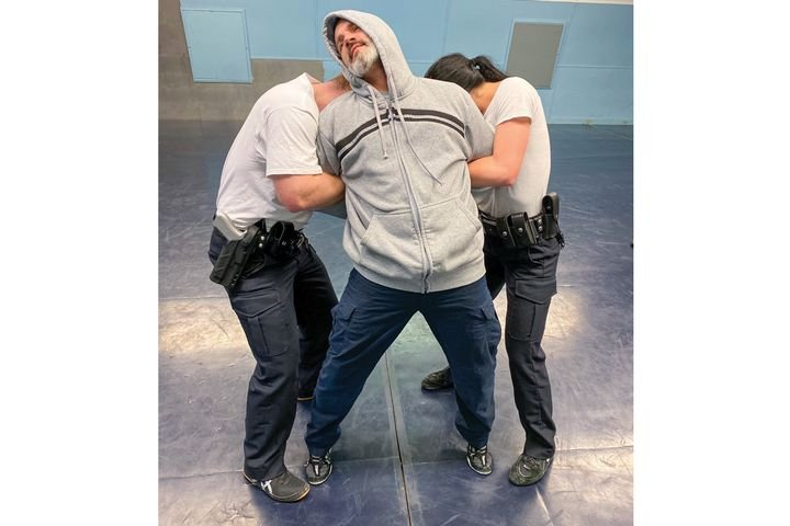 It is critical for officers to prepare by putting arrestees into some type of pain-free control hold so they can quickly and easily control and generate pain compliance when someone begins to resist. - Photo: Michael Schlosser