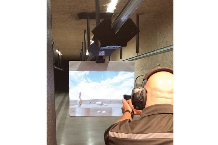 Installing Meggitt Training Systems' XWT ProImage projected target system allows you to use still and video image projection on paper at the range instead of traditional paper targets. - Photo: Meggitt Training Systems