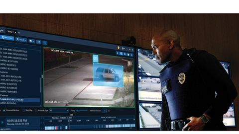 Officer monitoring the feeds from surveillance systems in Avigilon Control Room.