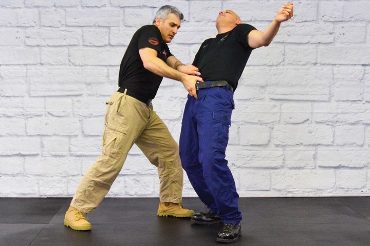 Police Krav Maga (Police KM) can be used for overall DT as well as to disarm a subject reaching for a weapon in the front of his waistband. - Photo: Rinaldo Rossi and Mimi Rowland