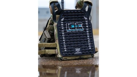 The I.C.E. panel from Body Armor Vent attaches to the officer's armor carrier and is worn...