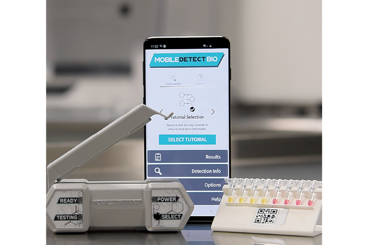 The MobileDetect Bio (DetectaChem) BCC19 COVID testing system includes the testing reagent, swabs, saline, PCR strips, and the thermal cycler for heating the material. A yellow result is positive and red is negative. It works with the MobileDetect app for documentation. -