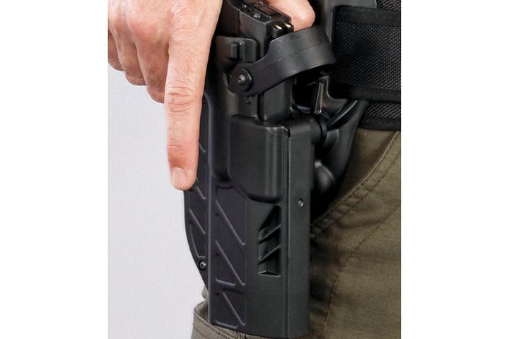 The Level 3 retention model of Gould & Goodrich's T.E.L.R. holster features a hood that the wearer disengages with their thumb. They then can disengage the ejection port lock as they draw. -