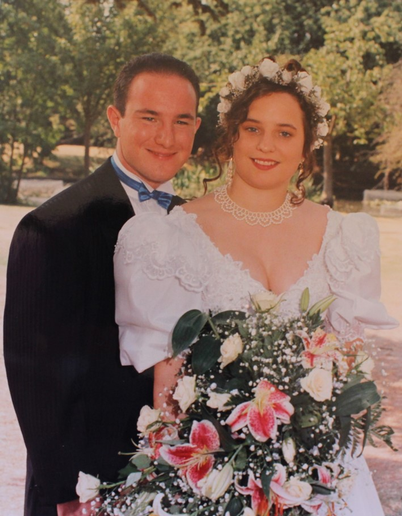 Kerry Avery, M.Ed. with her husband on their wedding day in 1995. 