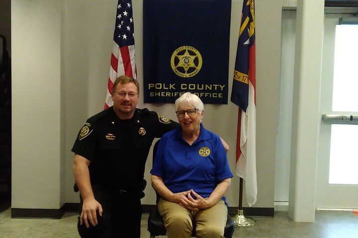 Polk County (NC) Sheriff Tim Wright with Peggy Wyllie, a newly minted non-sworn citizen volunteer with the agency. - Image courtesy of POLICE Magazine Contributing Web Editor Doug Wyllie / Facebook.