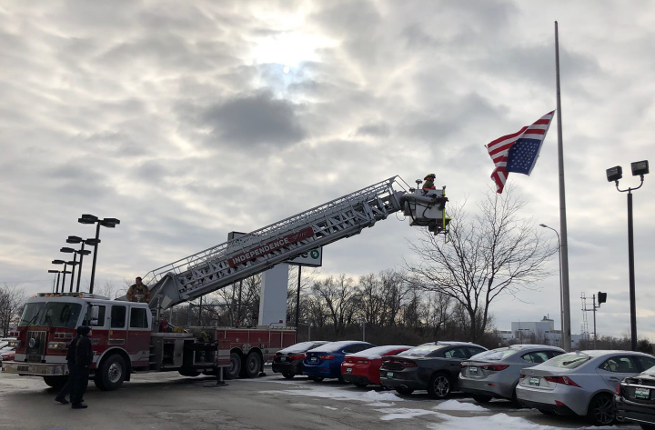 An officer with the Independence (MO) Police Department was on patrol when he noticed that the top part of an American flag had come apart from the flag pole it was flying from, rendering the stars and stripes to fly upside down.