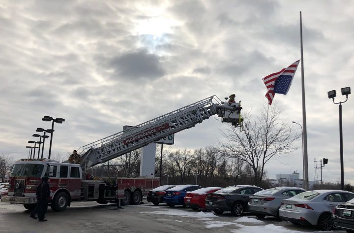 An officer with the Independence (MO) Police Department was on patrol when he noticed that the top part of an American flag had come apart from the flag pole it was flying from, rendering the stars and stripes to fly upside down.  - Image courtesy of Independence PD / Facebook.Image courtesy of Independence PD / Facebook.
