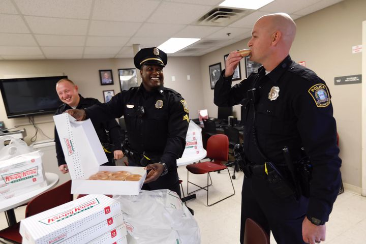 """When a social media post by the Lexington (KY) Police Department—showing officers appearing to be crying after fire destroyed a Krispy Kreme Doughnuts delivery truck—went viral, the confectioner company sent a message via twitter to the agency saying that more doughnuts are """"on the way."""" On Wednesday, the company delivered on its promise.  - Image courtesy of Lexington PD / Facebook."""