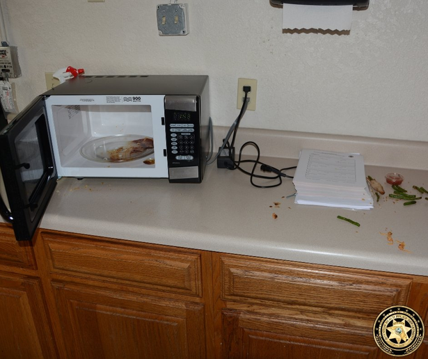 A Florida woman has been arrested after she broke into the Boynton Beach Police Department, took two readymade chicken and asparagus meals from the fridge, heated one of the meals in the microwave, and then left.  - Image courtesy ofBoynton Beach Police Department / Twitter.