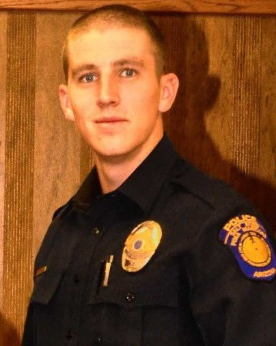 Officer Clayton Townsend was conducting a traffic stop on Tuesday night when a driver was allegedly seen crossing two lanes and crashing into the young officer. That driver—identified as 40-year-old Jerry Sanstead—was allegedly texting at the time.  - Photo: Salt River Police Department.