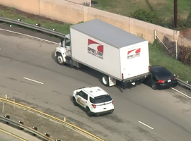 Three suspects in fleeing police after a residential burglary attempted to navigate their vehicle between the right shoulder barrier and a box truck in the right-hand lane of a Southern California freeway found themselves pinned between the two immovable objects.
