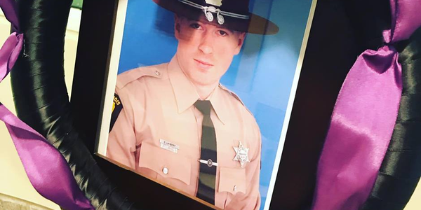 Trooper Christopher Lambert was reportedly out of his car, offering assistance at the scene of a...