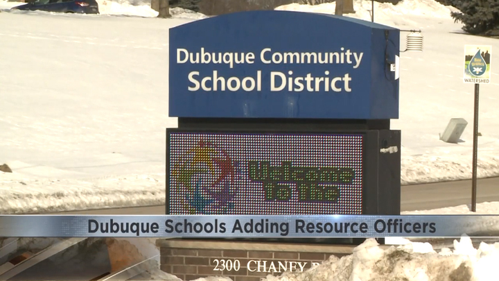 The Dubuque (IA) Police Department wants to add school resource officers to its ranks to protect children in the school district.  - Photo: KWWL screenshot