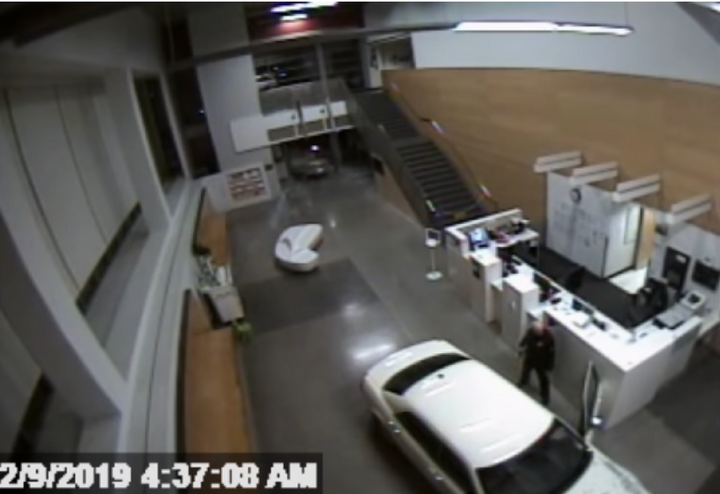 Los Angeles police officer speaks with suspect who reportedly drove car into station early Saturday morning. (Photo: LAPD Security Video)  -
