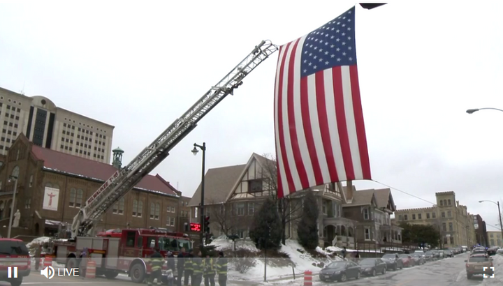 Flag honoring Milwaukee tactical officer killed Wednesday morning while serving a warrant. (Photo: WISN Screen Shot)