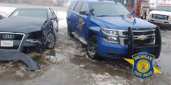 According to reports, at least a dozen Michigan State Police vehicles have been struck so far...