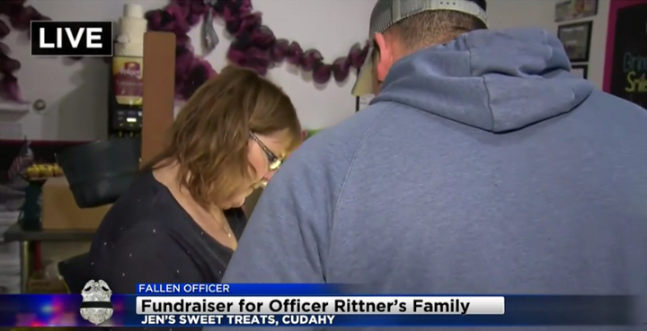 Jennifer Clark, the owner of Jen's Sweet Treats in Cudahy, WI, takes an order for baked goods. Clark donated 100% of all proceeds Tuesday to the family of slain Milwaukee officer Matthew Rittner. (Photo: CBS58 screen shot)