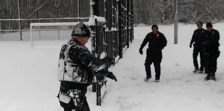 Officers with the Duvall (WA) Police Department took some time during Monday's inclement weather to have some fun with some young people at a local park.  - Image courtesy ofDuvall (WA) Police Department / Facebook.