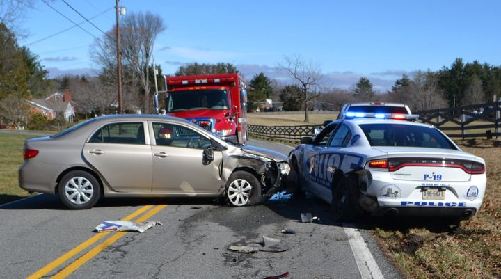 An officer with the Galax (VA) Police Department was reportedly injured when a passing Toyota Camry slammed into his squad car during a traffic stop on Saturday morning.  - Image courtesy of Galax PD / Facebook.