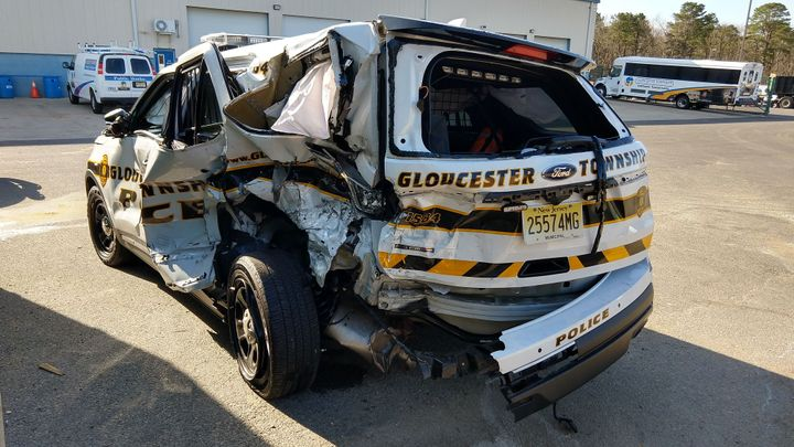 An officer with the Gloucester Township (NJ) Police Department suffered minor injuries when the patrol vehicle he was sitting in was struck by a suspected DUI driver.  - Image courtesy ofGloucester Township Police Department / Facebook.