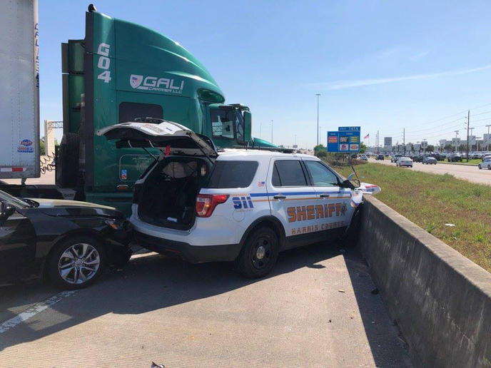 A deputy with the Harris County (TX) Sheriff's Office was injured when a tractor-trailer truck struck his patrol vehicle as well as another car early Wednesday.