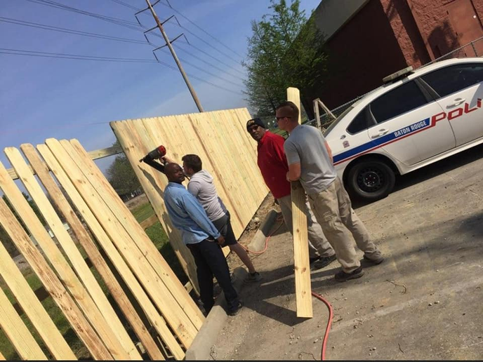 Officers with the Baton Rouge (LA) Police Department were joined by members of the community in an effort to rebuild the fence surrounding the fourth district precinct.  - Image courtesy of Baton Rouge PD / Facebook.