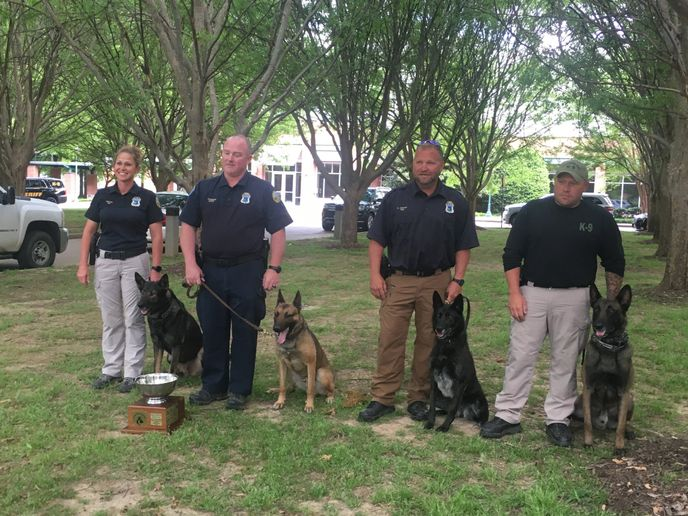 "Officer Timmons and K-9 ""Burt"" earned Overall Top Dog which means they earned the most points in Police Dog 1 and Narcotics Detection. Deputy Thompson and K-9 ""Eddy"" took First Place in Narcotics Detection.