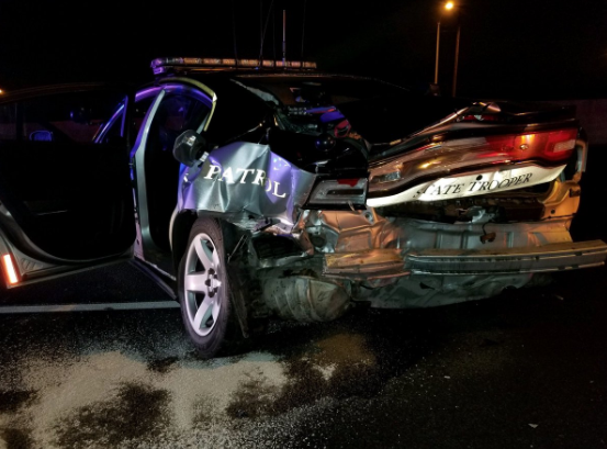 A trooper with the Colorado State Police was injured early Monday morning when a suspected DUI driver crashed into his parked patrol vehicle.