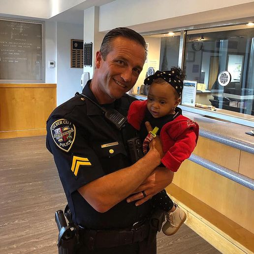 Officer Brian Cappell was the first on scene and followed the baby's sister to the 9-month-old who had reportedly choked on a snack.In a ceremony held by the city council, Officer Cappell was reunited with the grateful mother and her child.  - Image courtesy of Culver City Police Department / Facebook.