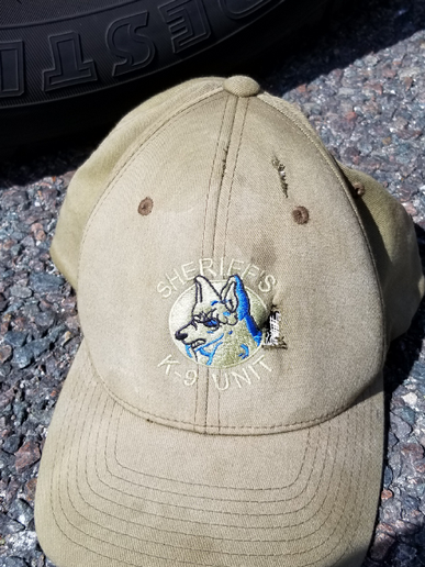 Sgt. Thomas Dane of the Volusia County (FL) Sheriff's Office was wearing this hat when he was shot with a .32 caliber handgun Thursday. The bullet punctured his K-9 baseball cap in two places and cut through his scalp. Sheriff Mike Chitwood says Dane escaped death by a millimeter. (Photo: Volusia County SO)