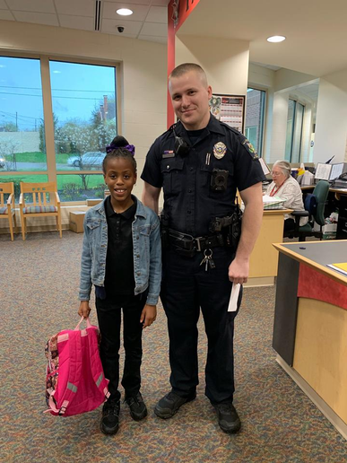 Officer Raymond Seehousen with the Mount Healthy (OH) Police Department escorted a little girl to school for the annual Father/Student day on Friday because the child's dad had recently been deployed for duty with the United States Army.  - Image courtesy ofMount Healthy Police Department / Facebook.