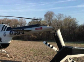 An Omaha Police helicopter made a rough landing after mechanical failure Tuesday. No one was injured. (Photo: KETV screen shot)