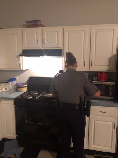 Sergeant Wendy Brewer and Officer Kegan Bostic kicked into action, searching the kitchen for something for the man to eat. Finding the cupboards bare but for a box of pancake mix, they set about the simple gesture of making a stack of pancakes for the man in need.  - Image courtesy of Bristol PD / Facebook.