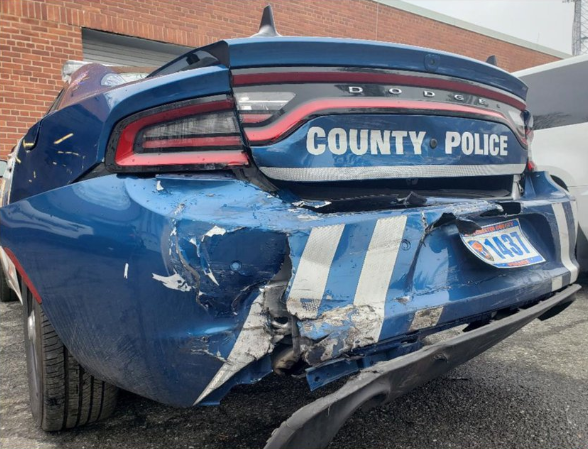 According to the Westchester Journal News, a 24-year-old woman—who has not yet been named—was driving a Chevy Impala when she slammed into the back of the patrol car on a local freeway.