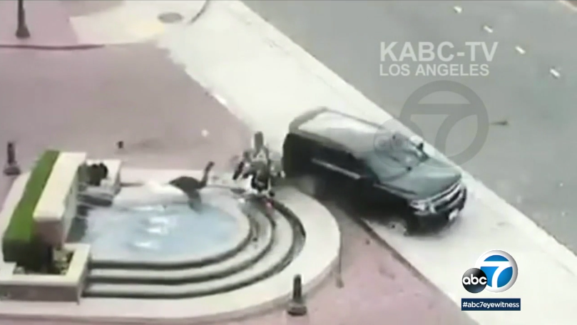 Video: Vehicle Crashes into LAPD Officer, Launches Him into Fountain
