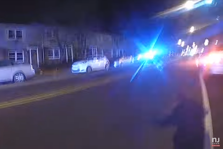 Body camera video of the incident, released Tuesday night, shows Crespo jumping out of his...