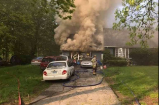 Shelton, CT, police officerMichael Kichar saved two people from this house fire. (Photo: Shelton Fire Department)  -