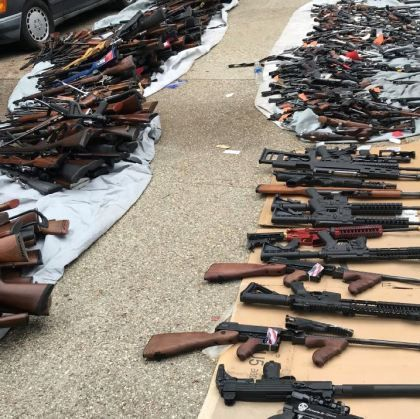 Officers seized more than 1,000 illegal firearms that were reportedly being sold to gang members. 