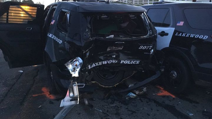 An allegedly drunk driver crashed into this Lakewood, CO, police vehicle Saturday, injuring an officer and a DUI suspect who was being arrested. (Photo: Lakewood PD)