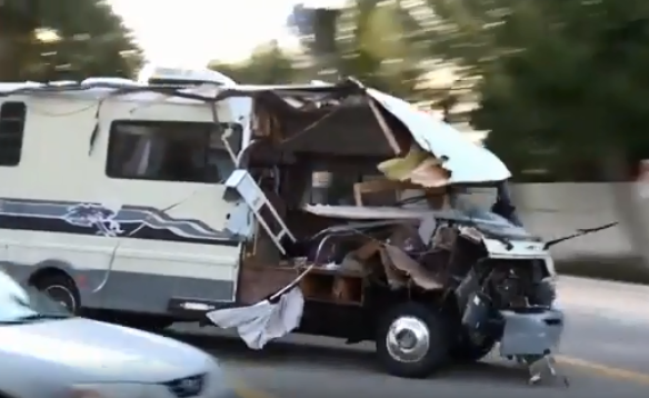 Screen grab of video captured of a woman in a stolen RV leading police on a wild chase.  -