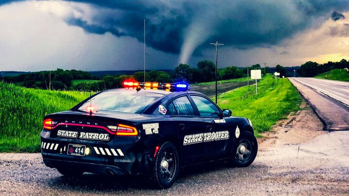 """The Nebraska Highway Patrol posted an image to its Facebook page with the caption, """"This tornado crossed Highway 75 just south of Dawson tonight in Richardson County. Trooper Zost had this incredible view. He reports it stayed in a field so not likely much damage to structures, if any. """"  - Image courtesy ofNebraska Highway Patrol / Facebook."""