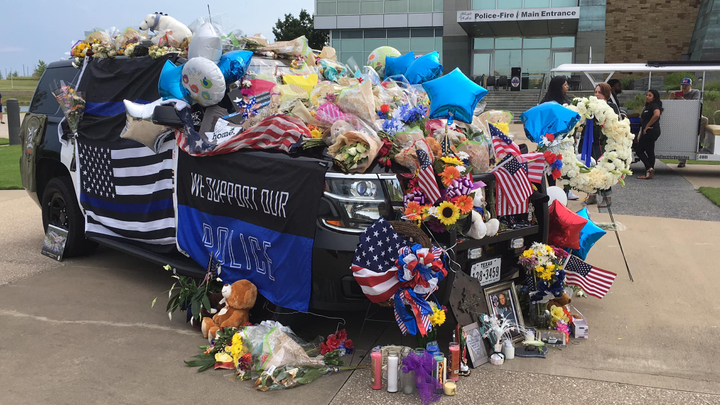 Hundreds of citizens joined officers with the Grand Prairie Police Department at a candlelight vigil Sunday night in honor of Officer Albert Castaneda, who was struck and killed by a car while standing outside of his patrol vehicle running radar on the President George Bush Turnpike.  - Image courtesy ofGrand Prairie Police Department / Facebook.