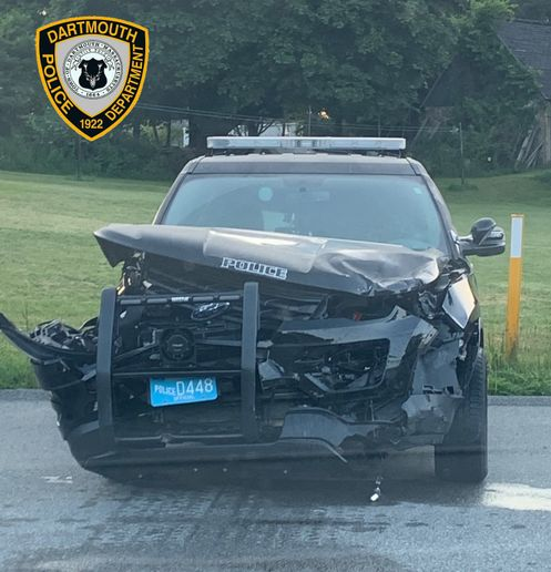 An officer with the Dartmouth (MA) Police Department was injured on Sunday when his patrol vehicle was struck by a suspected drunk driver.  - Image courtesy of Dartmouth PD / Facebook.