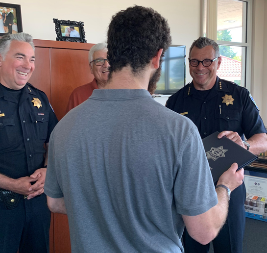 The Santa Cruz (CA) Police Department has awarded an anonymous Good Samaritan—who intervened when an alleged assault occurred on a local store owner—a Chief's Commendation and Challenge Coin.