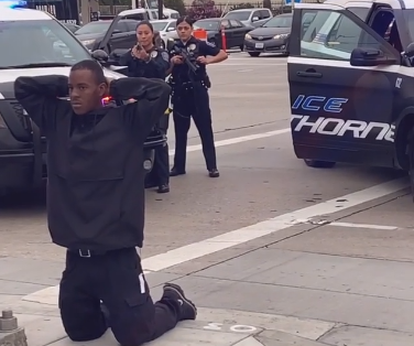 Hawthorne, CA,police detain a robbery suspect. The incident was captured live on Instagram by a civilian and spread on social media. The video has led to claims of excessive force. (Photo: Instagram Video Screen Shot)  -
