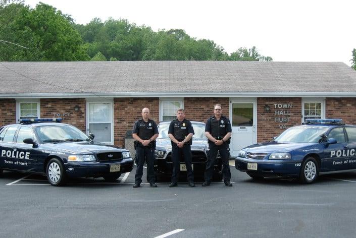 "Left to Right are Patrolman Jason Lovelace, Chief Ronald Rowland, Patrolman Henry ""Buzz"" Harmon of the Hurt (VA) Police Department.  - Image courtesy of Hurt PD."